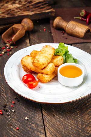 Side view on deep fried mozzarella cheese with sauce on the wooden table Фото со стока - 155774952