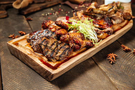 Closeup on assorted roasted meat set on the wooden board