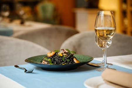 Black spaghetti with seafood and saffron sauce with white wine