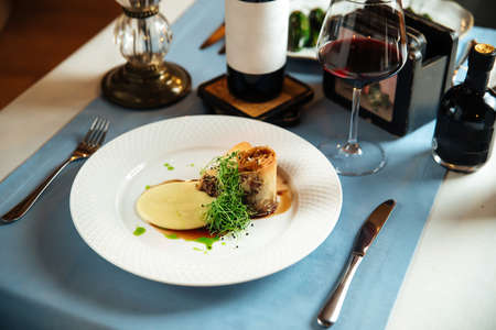 Spanish cuisine dish rabo de toro oxtail stewed in wine on the restaurant table