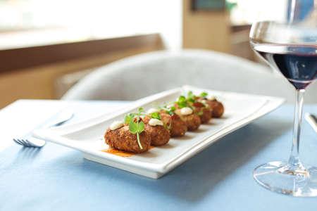 Side view on spanish delicacy fried potato balls croquettes Фото со стока