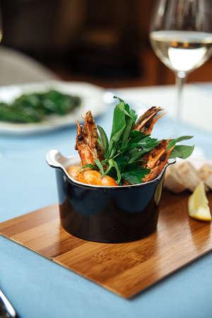 Closeup on spanish dish gambas pil-pil shrimps on the restaurant table