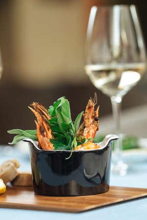 Closeup on spanish dish gambas pil-pil shrimps on the restaurant table Фото со стока - 156337212