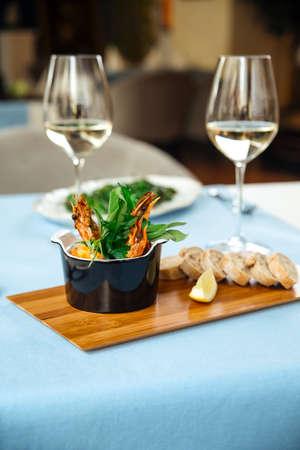 Spanish dish gambas pil-pil shrimps on the restaurant table