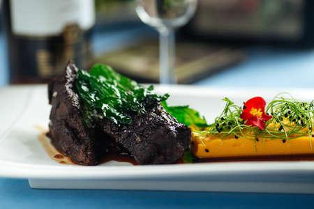 Closeup on spanish veal cheeks in wine sauce and sweet potato puree