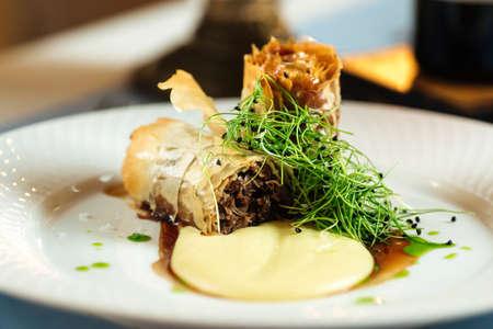 Closeup on spanish cuisine dish rabo de toro oxtail stewed in wine
