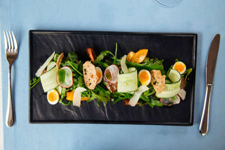 Top view on fresh vegetables salad on the served restaurant table Фото со стока - 156429531