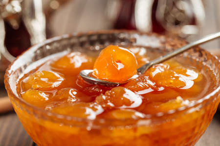 Closeup on white cherry jam in a glass bowl with spoon