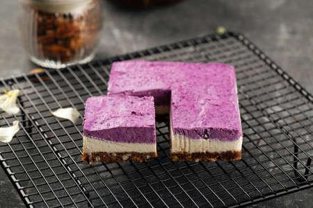 Closeup on no bake eco-friendly blueberry cake on metal mesh tray