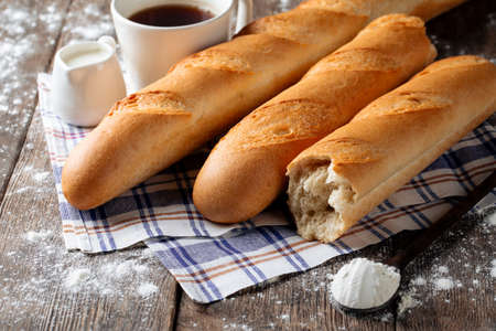 Several french baguettes with coffee and milk