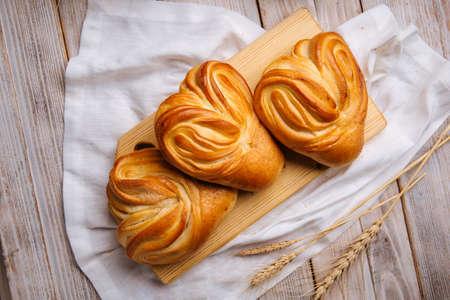 Top view on fresh baked heart shaped buns Фото со стока