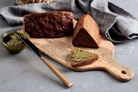 Side view on sliced flourless diet grain bread Фото со стока