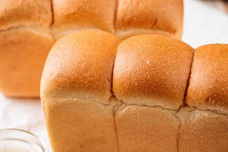 Loafs of fresh baked shaped wheat bread