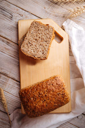 Side view on fresh baked cut whole wheat bread Фото со стока