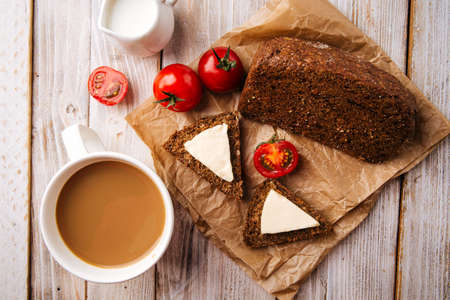 Flourless diet grain bread with cheese and coffee