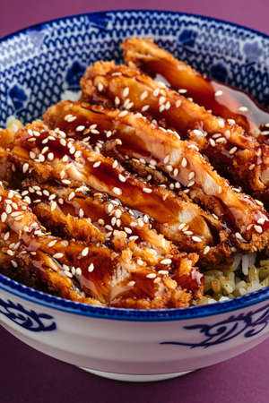 Katsudon fried chicken with rice in a bowl