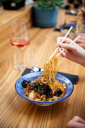 Eat ebi shrimp ramen noodle soup with chopsticks