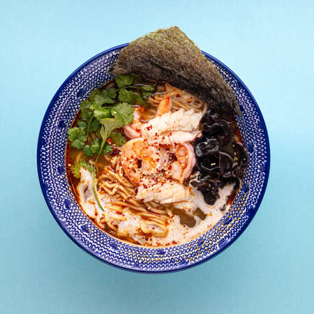 Asian ebi ramen noodle soup with shrimp Фото со стока