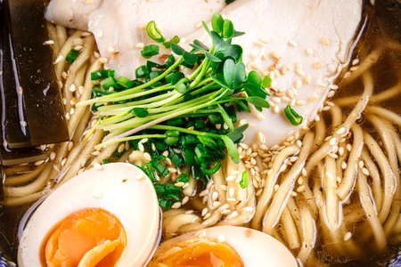 Shio ramen noodle soup with chicken and eggs