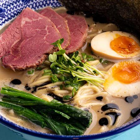 Tori paitan ramen soup with pastrami and eggs Фото со стока