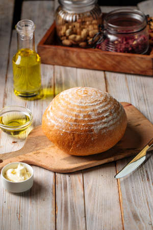 Loaf of olive oil bread on the wooden table