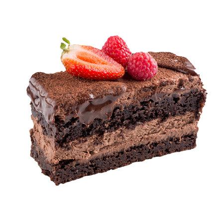 Isolated chocolate layered cake slice with berries