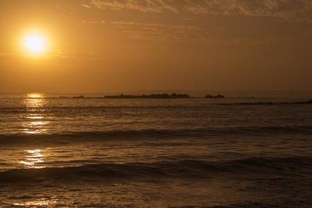 Beautiful orange sunset over the atlantic ocean Stock Photo