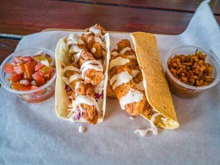 Fish tacos with salsa and rice