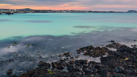 Jeju golden hour seascape view. Very beautiful glowing color tone from the water. Stock Photo