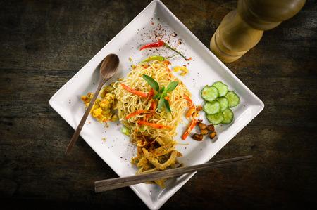 pepper grinder: Stir fried rice noodles with pepper grinder and wooden spoon