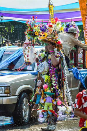 Chiang Rai, Thailand - April 12, 2015 : The Songkran festival parade. Songkran is the holiday known for its water festival