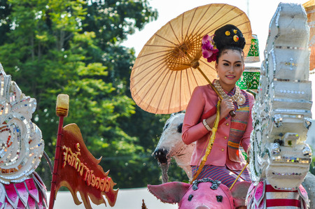 Chiang Rai, Thailand - April 12, 2015 : The Songkran festival parade. Songkran is the holiday known for its water festival. The girl is crowned to be Miss Songkran