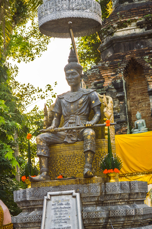 reportedly: Chiang Rai, Thailand - October 1, 2016: The memorial to King Mengrai and a small chedi reportedly containing the ashes of King Mengrai