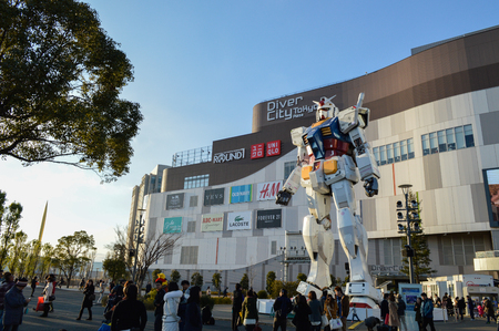 replica: Tokyo, Japan. 13 January 2014. Gundam Statue Model Performances Outside Diver City Tokyo Plaza, landmark in Odaiba
