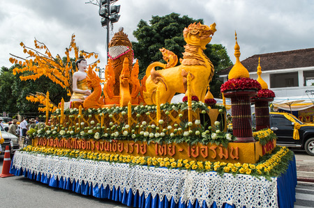 beeswax candle: Chiang Rai, Thailand - July 7, 2017 : Candle Festival Parades are paraded around Chiang Rai town.  In Thailand associates with Buddhist agenda called Buddhist Lent. The ornately carved beeswax candles.
