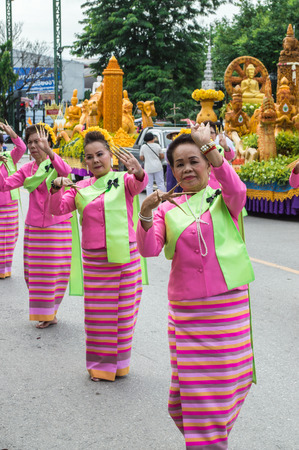 Chiang Rai, Thailand - July 7, 2017 : Candle Festival Parades are paraded around Chiang Rai town.  In Thailand associates with Buddhist agenda called Buddhist Lent. Women dancing in the parade