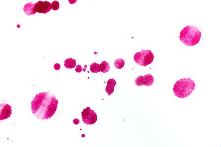 Watercolor splash on white background, pink color Foto de archivo