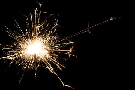 Firework sparkler burning on black background Stock Photo