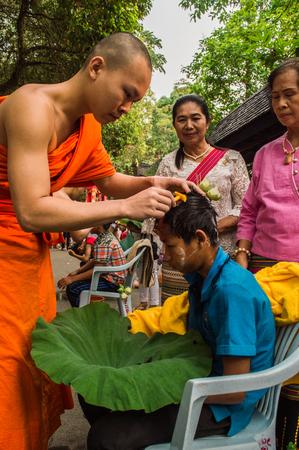 Chiang Rai, Thailand - April 1, 2018 : The Ordination Ceremony of the 2018 Ordination Program at Wat Phra Kaew Chiang Rai, hair shaving before ordination.
