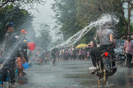 Chiang Rai, Thailand - April 13, 2018 : Songkran festival at Suan Tung Lae Khom Chiang Rai Park in Chiang Rai. People funny playing water.