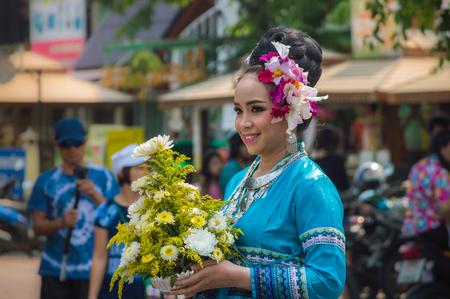 Chiang Rai, Thailand - April 13, 2018 : Songkran festival at Suan Tung Lae Khom Chiang Rai Park in Chiang Rai. Participants in a Songkran Festival parade.