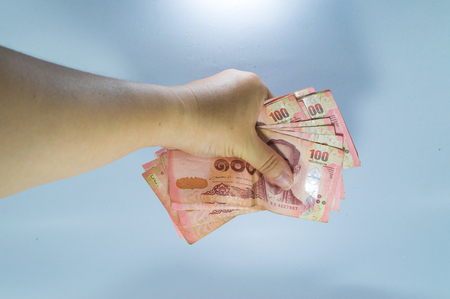 Thai baht banknotes in hand isolated on white background Stock Photo