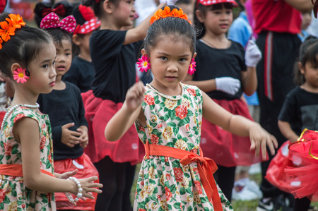 CHIANG RAI, THAILAND - September 14, 2018 : Chiengrai Vidhayakhome School students parade in annual Sports Days. Elementary students are dancing performing show. Editorial