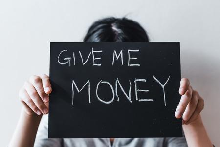Asian woman asking for money Фото со стока