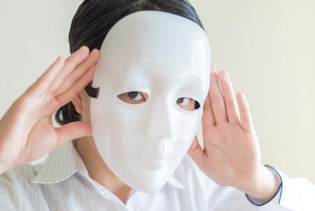 white mask: Asian woman wearing white mask