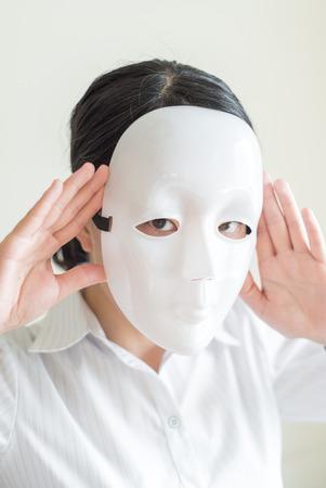 inexpressive: Asian woman wearing white mask