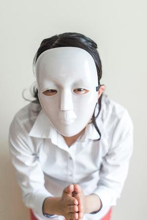 inexpressive: Asian woman wearing white mask apologize Stock Photo