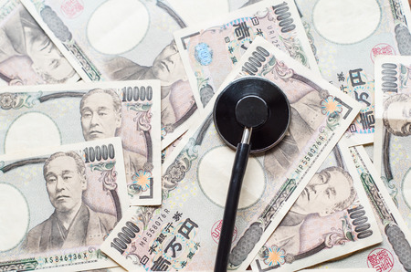 staging: Stethoscope and ten thousands japanese yen