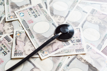 thousands: Stethoscope and ten thousands japanese yen
