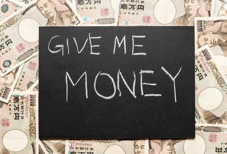 penury: Give me money on the blackboard Stock Photo